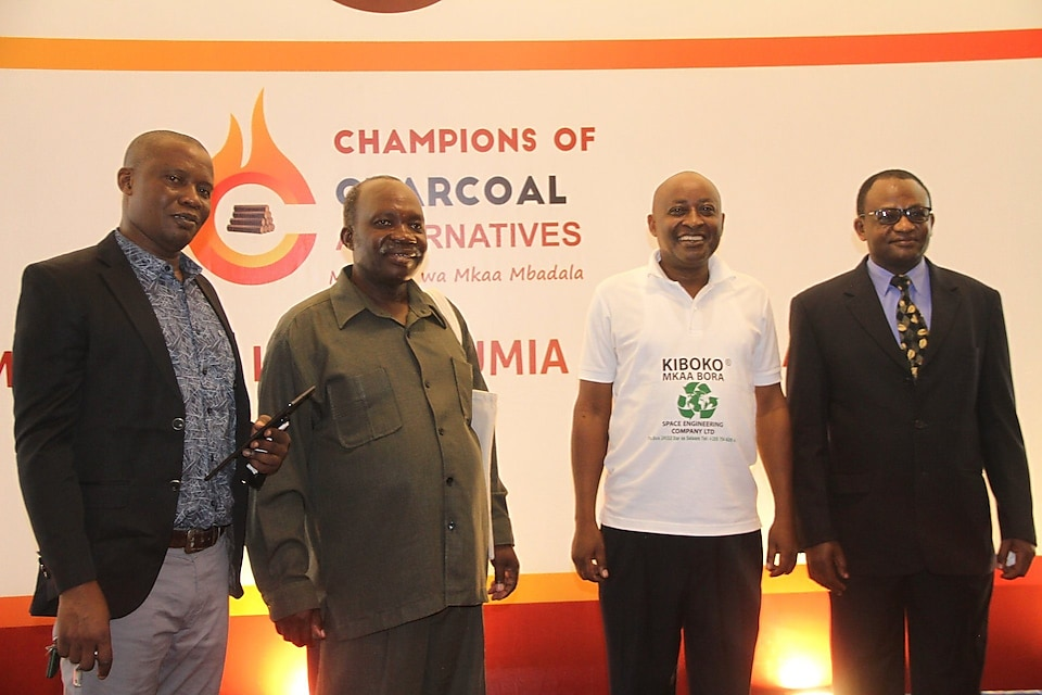 3 Institute of Management and Entrepreneurship Development CEO Dr. Donath Ulomi Posed for a photo with the winners of a competition on alternative energy. From Left Leonard Kushoka, Anyelwise Mahenge and Philip Mtui.